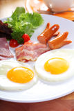 Breakfast with egg, ham, bacon, sausage Royalty Free Stock Photography