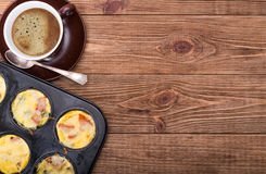 Breakfast egg muffins. Cup of coffe. Stock Photography