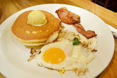 Breakfast with egg, pancake and bacon. American breakfast with egg, pancake and bacon Stock Photo