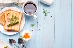 Breakfast with egg and a cup of coffee Royalty Free Stock Photo