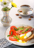 Breakfast with egg poached, toasted, bacon, tomatoes and coffee Royalty Free Stock Photography