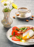 Breakfast with egg poached, toasted, bacon, tomatoes and coffee Stock Photography