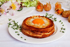 Breakfast egg in puff pastry basket, rustic, rural, baking, the idea of a recipe Royalty Free Stock Photo