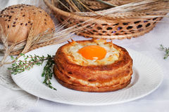 Breakfast egg in puff pastry basket, rustic, rural, baking, the idea of a recipe Royalty Free Stock Photos