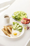 Breakfast with egg toast fruit and vegetable salad Stock Photo