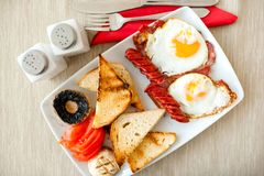 Breakfast with eggs, bacon, sausages, toast bread Royalty Free Stock Image
