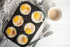 Breakfast eggs baked in cake mold with ground parmesan Royalty Free Stock Photos