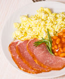 Breakfast with eggs, beans and meat Royalty Free Stock Photos