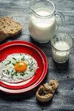 Breakfast of eggs, bread and milk Royalty Free Stock Photography