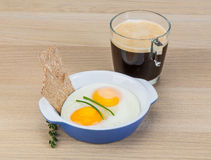Breakfast with eggs and coffee Royalty Free Stock Images