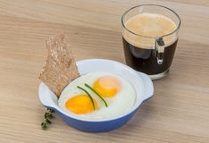 Breakfast with eggs and coffee Stock Images