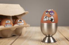 Breakfast eggs with faces. On wooden work top stock image