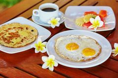 Breakfast with eggs, pineapple pancake and fruits Stock Photography