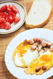 Breakfast with eggs, sausage and bread Royalty Free Stock Images