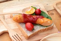 Breakfast with eggs, sausage, bread, salad vegetables and milk. Royalty Free Stock Images