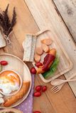 Breakfast with eggs, sausage, bread, salad vegetables and milk. Stock Images
