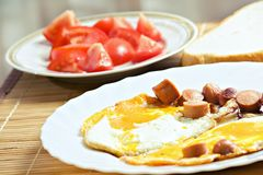 Breakfast eggs, sausage, bread and tomato Royalty Free Stock Images
