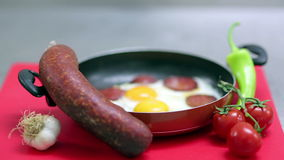 Breakfast of eggs and sausage stock video