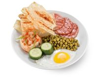 Breakfast with eggs , sausages, croutons and peas Stock Photo