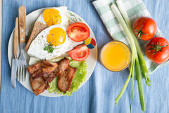 Breakfast. With eggs and some ingredients,bread,Sausage,and fresh salad Stock Photos