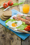 Breakfast. With eggs and some ingredients,bread,Sausage,and fresh salad Stock Images