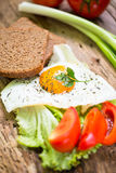Breakfast. With eggs and some ingredients,bread,Sausage,and fresh salad Stock Image