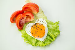 Breakfast. With eggs and some ingredients,bread,Sausage,and fresh salad Royalty Free Stock Photo
