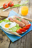 Breakfast. With eggs and some ingredients,bread,Sausage,and fresh salad Stock Photography