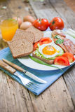 Breakfast. With eggs and some ingredients,bread,Sausage,and fresh salad Royalty Free Stock Photos
