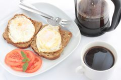 Breakfast of eggs on toast with coffee royalty free stock image