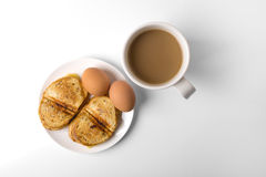 Breakfast with eggs, toasts, and coffee Stock Photo
