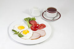 Breakfast. Eggs with tomatoes and tea isolated on gray background Royalty Free Stock Images