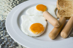 Breakfast. English breakfast with fried eggs, sausages, toasts Royalty Free Stock Image