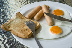 Breakfast. English breakfast with fried eggs, sausages, toasts Stock Photos