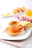 Breakfast with espresso coffee and biscuits Stock Photos