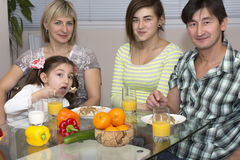 Breakfast of family with mix race different Stock Photos