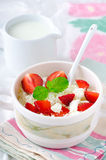 Breakfast with farmer cottage cheese, strawberries and mint. On white background Royalty Free Stock Photo