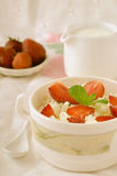 Breakfast with farmer cottage cheese, strawberries and mint. On white background Stock Photos