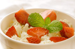 Breakfast with farmer cottage cheese, strawberries and mint. On white background Royalty Free Stock Images