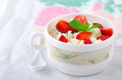Breakfast with farmer cottage cheese, strawberries and mint. On white background Stock Image