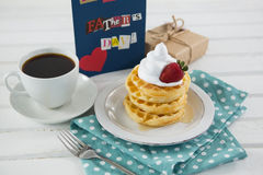 Breakfast by fathers day greeting card on table stock image