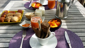 Breakfast feast with rolls, coffee and juice on table Stock Photography