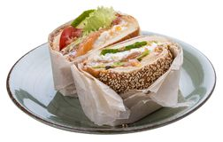 Breakfast. Fish Burger with salmon and salad stock photo