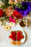 Breakfast with flowers stock images