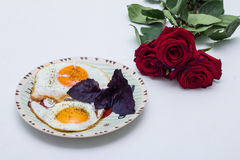 Breakfast with flowers and eggs Royalty Free Stock Photo