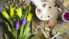 Breakfast with flowers, rustic style, top view, slow motion stock video