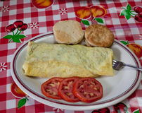 Breakfast Food. An Omelette, biscuits, and tomatoes for a breakfast meal Stock Photos