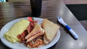 Breakfast food omelette bread hash browns restaurant bar. Food I had in the morning at the restaurant Stock Photo