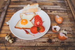 Breakfast foods toast , egg, tomato , bread Royalty Free Stock Images