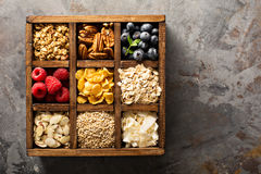 Breakfast foods in a wooden box overhead shot Stock Photos